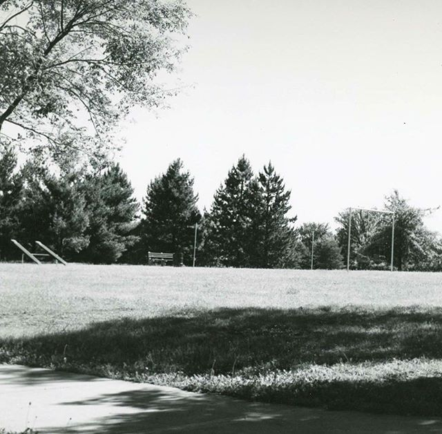 "{Throwback Thursday} HOLMES PARK circa 1950In 1943 two proposals were made to establish a park and playground in what was then the southwest part of the city.  One was made by Dr. Hayes Richardson, Director of the Welfare Department, for the use of empty ground between 67th and 70th Streets, Holmes and Campbell.  The other was made by architect for the Park Board S. Herbert Hare for property from 65th to 67th, Rockhill Road to Troost. In October 1943, the Park Board recommended that the property at 69th and Holmes be acquired as a ""playfield"". The Board voted to condemn property for it in August 1944.  Known as ""69th Street Park"" and ""69th and Holmes Park"" the name was changed to Holmes Park in 1970, although it had been unofficially called that for some time.The park/playfield at 69th and Holmes was to be the first of four playfield areas the southwest part of the City.  Of the locations suggested in 1943 only this one and one near the water tower at 75th and Holmes (now Tower Park) were constructed.Holmes Park is a popular and well-used park with one baseball diamond, a playground, and open space. A roller hockey rink was constructed in 1999 where there had previously been tennis courts.  There have been recent improvements to the roller hockey area with more planned. A Boy Scout fire ring is located in the northeast corner of the park.  It is called the Burr Oak Council Ring and is used for Boy Scout ceremonies. #KCParks125 #FromTheArchives #TBT #ThrowbackThursday"